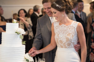 white-room-reception-grand-ballroom-cake-cutting