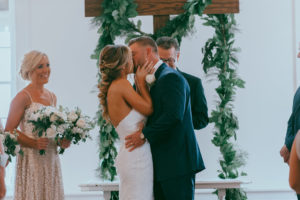 white-room-ceremony-villa-blanca-first-kiss