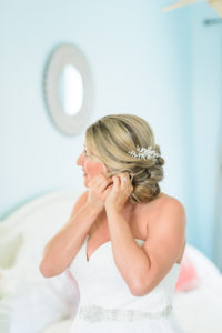 St Augustine Wedding Venue Bride putting on earrings