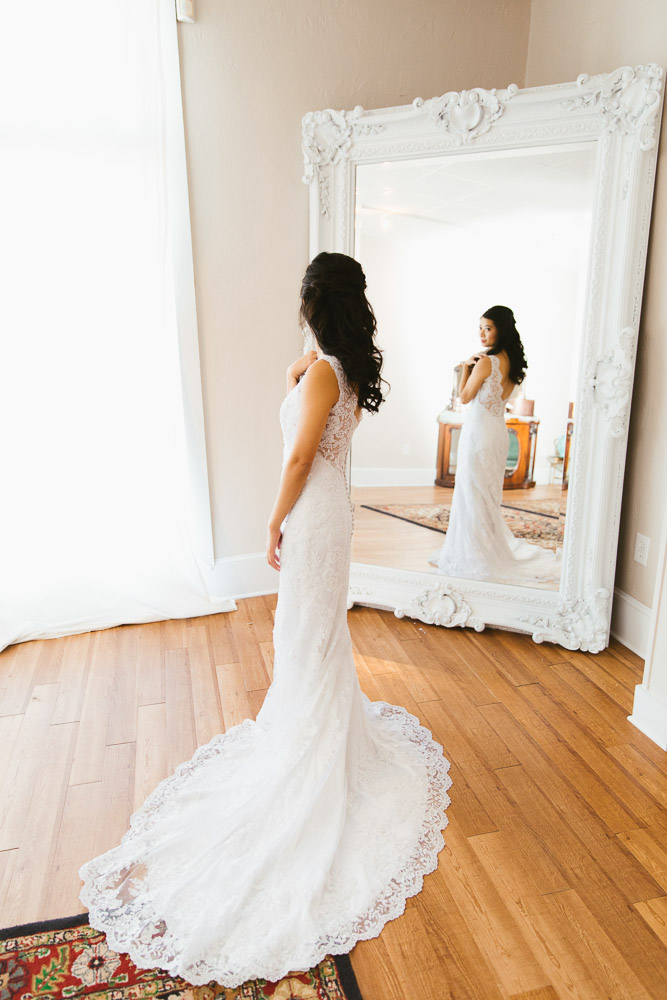 St Augustine Wedding Bride Looks in Mirror