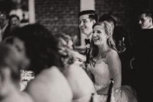 st-augustine-florida-wedding-venues-white-room-champagne-toasting-bride-groom