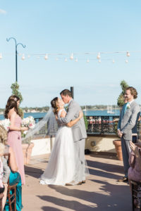 white-room-rooftop-wedding-st-augustine-florida-first-kiss