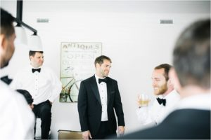 st-augustine-florida-destination-wedding-white-room-groom-groomsmen