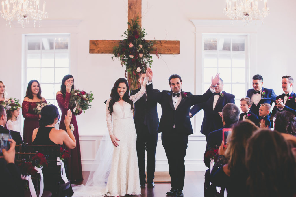 St. Augustine Bride and Groom Celebrate down Aisle