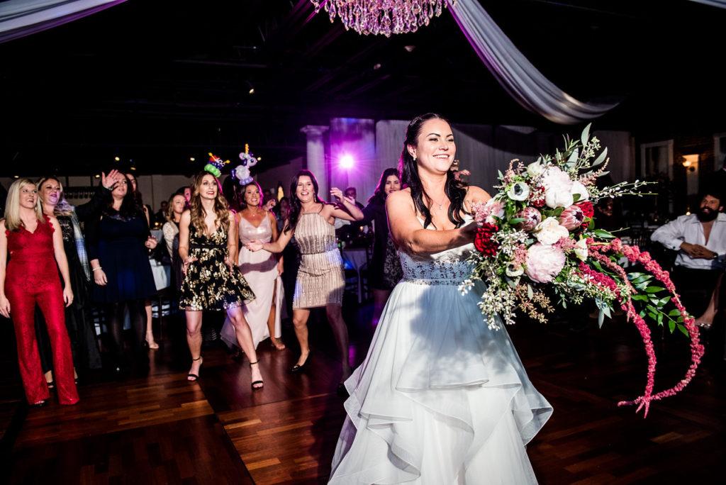St. Augustine Winter Wedding Ballroom Bouquet Toss